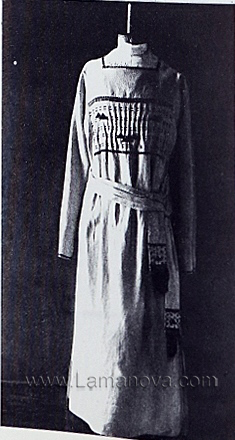 A dress decorated with braid